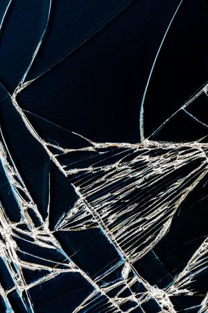 cracked glass: Cracked glass of broken blackhround Stock Photo
