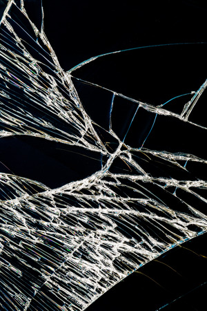 Cracked glass of broken blackhround Stock Photo