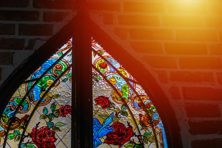 Stained glass  colorful window  is  roses
