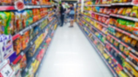 People shopping in department store. Defocused blur background