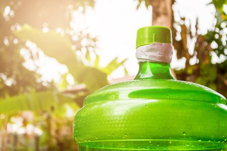 Large water bottle green background