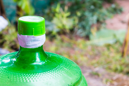 purified: Large water bottle green background