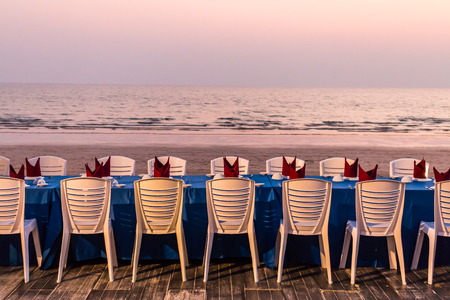 Table set at the beach part in the evening.