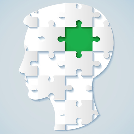 brain puzzle: Human face in the form of a puzzle with a green mid  business concept