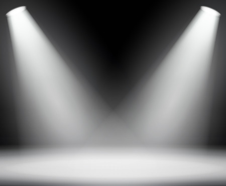 Dark background with spotlights light. Studio.