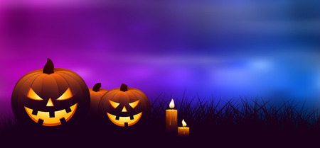 spooky forest: Halloween pumpkins with candles in a spooky forest at night.