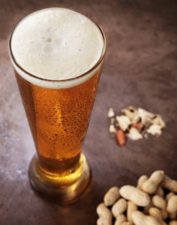6 pack beer: Beer and Peanuts Stock Photo