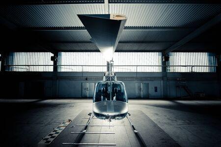 silver bells: Bell Jet Ranger 206B in Hangar Stock Photo