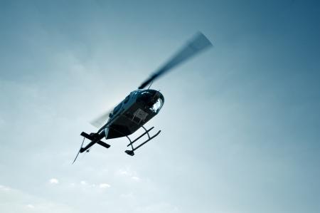 ranger: Bell Jet Ranger 206B flying over camera Stock Photo
