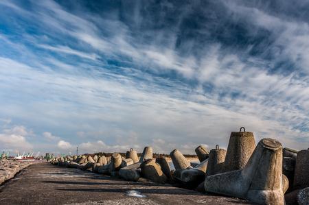 breakwater: breakwater and cloudy sky Stock Photo