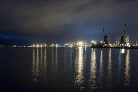 nocturnal: Klaipeda port nocturnal photography. Reflections in water.