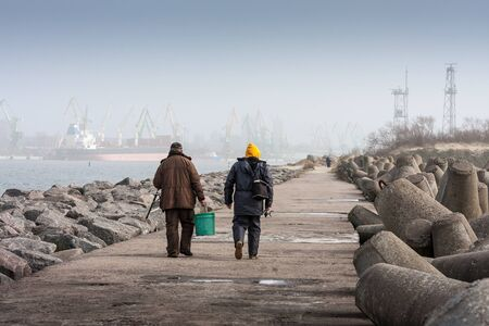 habour: Fishermen walks along a habour.