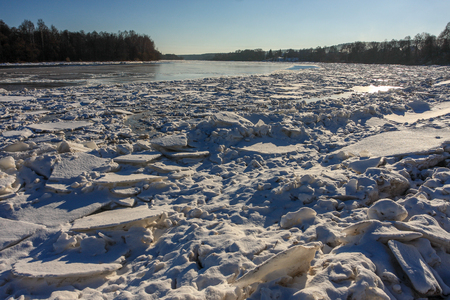 The river in the winter, a lot of ice on shore.