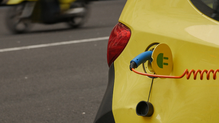 Power supply for electric car charging. City electric car charging station. Close-up. 스톡 콘텐츠
