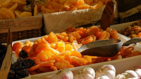 Dried apricot fruit on heap at marketplace. Close up.