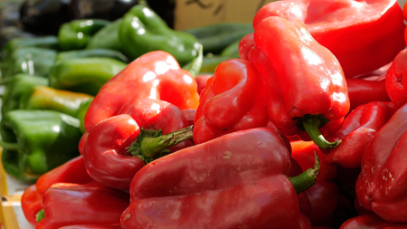 Fresh peppers with price on display in market. 스톡 콘텐츠