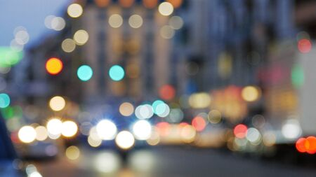 Night city lights and traffic. Out of focus background with blurry unfocused city lights and driving cars. 스톡 콘텐츠