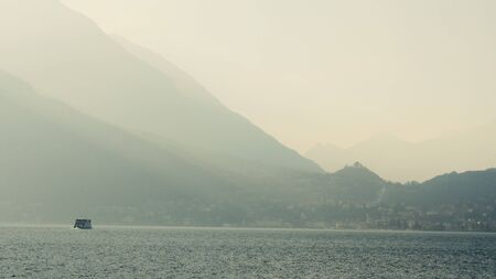 Italy, Lake Como. Wide Shot, a ferry in the distance 스톡 콘텐츠