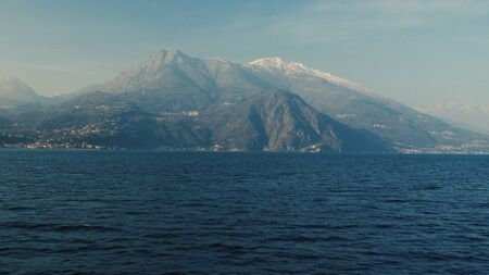 Panoramic view of Lake Como, the Alps above it and the nature around it.