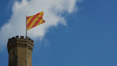 Castle tower with flag. Southern France, Europe 스톡 콘텐츠