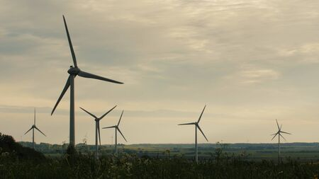 Wind turbines in the field, overcast. Clean and Renewable Energy, Wind Power, Turbine, Windmill, Energy Production 스톡 콘텐츠