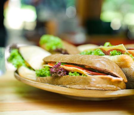 Sandwich on a wooden plate