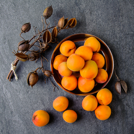 Apricots in a metal pial are stacked Banco de Imagens