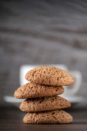 cup of coffee with oatmeal cookies on a wooden table
