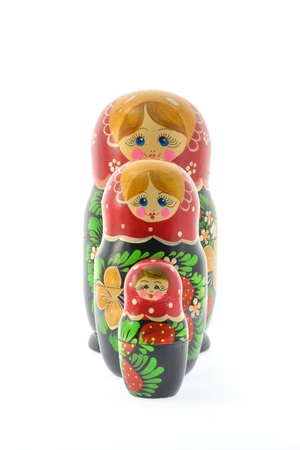 straight line: Three Russian dolls lined up in a straight line on the growth