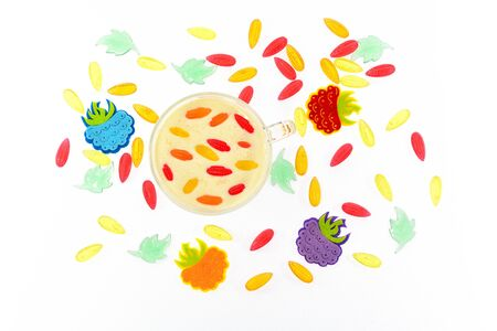 A cup of milk with marmelodom and berries on a white background photo