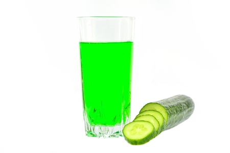 Cucumber juice and sliced cucumber into slices on a white background Banco de Imagens