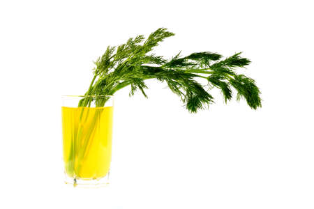 non alcoholic beverage: Lemon juice with a bunch of dill on a white background