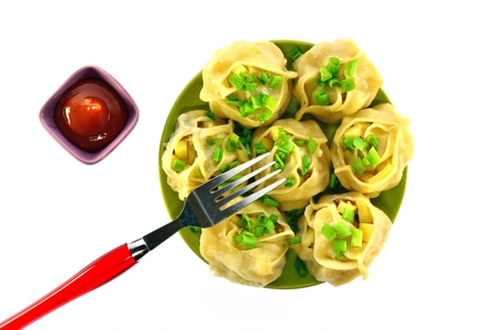 creative force: Tatar national dish manti with ketchup on a white background