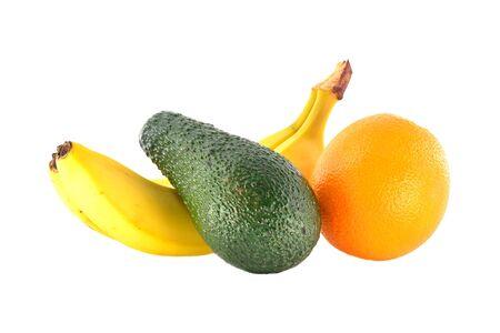 Ripe banana, tangerine and avocado on a white background photo