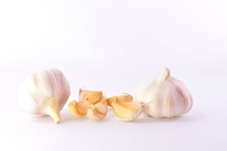 two heads: Two heads mature garlic cloves and a white background Stock Photo