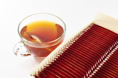 Black tea and packing on a white background photo