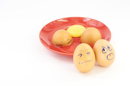 breaks: Steel knife breaks the eggs on a white background