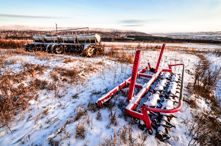 Agricultural units in the winter under a layer of snow photo