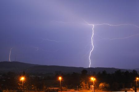 thundershower: Lightning in the night sky over the city