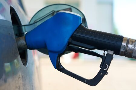 fueled: The car is fueled with gasoline at a gas station Stock Photo