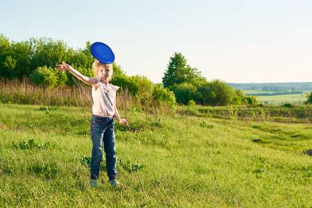 flying disc: Girl playing flying disc in the park in summer