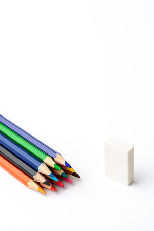 erasers: Colored pencils on white paper and erasers