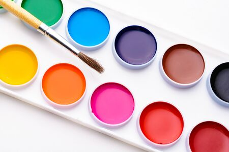 pencils  clutter: The palette of watercolor paints and brush on a white background