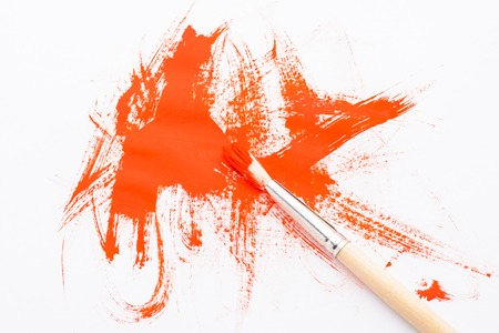 Figure red paint brush on a white background Banco de Imagens