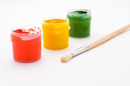 pencils  clutter: Paint in jars and brush for drawing on a white sheet of paper Stock Photo