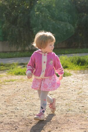 escapes: The little girl in a pink blouse looking escapes