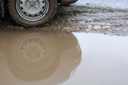 muddy: Reflection wheel car in a muddy puddle