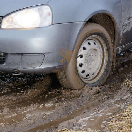driving conditions: The car rides through the mud and slips