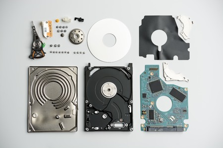 Disassembled laptop hard drive on a white background