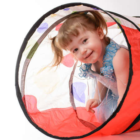assiduous: Little girl is happy and playing in the house